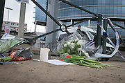 Flowers for victims and police guarding the road to  Maelbeek Metro station the Day after the explosions in Brussels. Photo: Erik Luntang