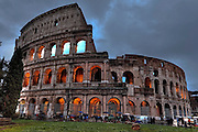 The Colosseum in Rome, Lazio, Italy illuminated at Christmas time in the evening.