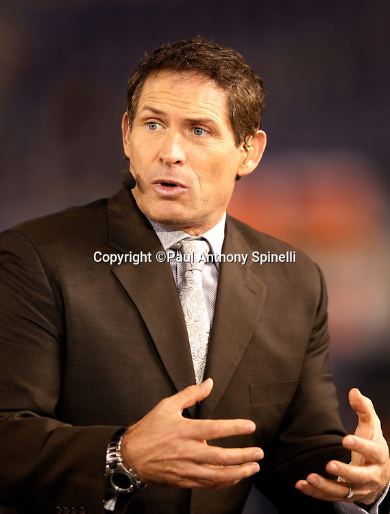 ESPN game analyst Steve Young makes a point while working at the San Diego Chargers NFL week 11 football game against the Denver Broncos on Monday, November 22, 2010 in San Diego, California. The Chargers won the game 35-14. (©Paul Anthony Spinelli)