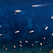 Yachts and boats in a harbour on the island of Capri, Italy.<br />