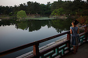 "Girl enjoying the evening at Anapji pond in the city of Gyeongju. Gyeongju was the capital of the ancient kingdom of Silla (57 BC - 935 AD) which ruled most of the Korean Peninsula between the 7th and 9th centuries. A vast number of archaeological sites and cultural properties from this period remain in the city. Gyeongju is often referred to as ""the museum without walls"". / Gyeongju, South Korea, Republic of Korea, KOR, 20th of May 2010."
