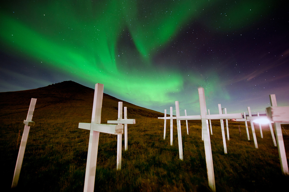 Glowing under the aurora borealis, a memorial of crosses along the Hwy between Selfoss and Reykjavik, Iceland dedicated to those who lost their lioves in car accidents.