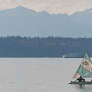 "Relaxing in a ""Kool"" sail boat in Puget Sound, near West Point, West Seattle, Washington.  Photo By William Byrne Drumm."