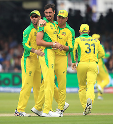 Australia's Mitchell Starc (centre) celebrates taking the wicket of England's Eoin Morgan with team mates during the ICC Cricket World Cup group stage match at Lord's, London.