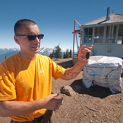 Dan the Fire Lookout Showing Off Unique Cone of Subalpine Fir (Abies lasiocarpa), Desolation Peak, North Cascades National Park, Washington, US