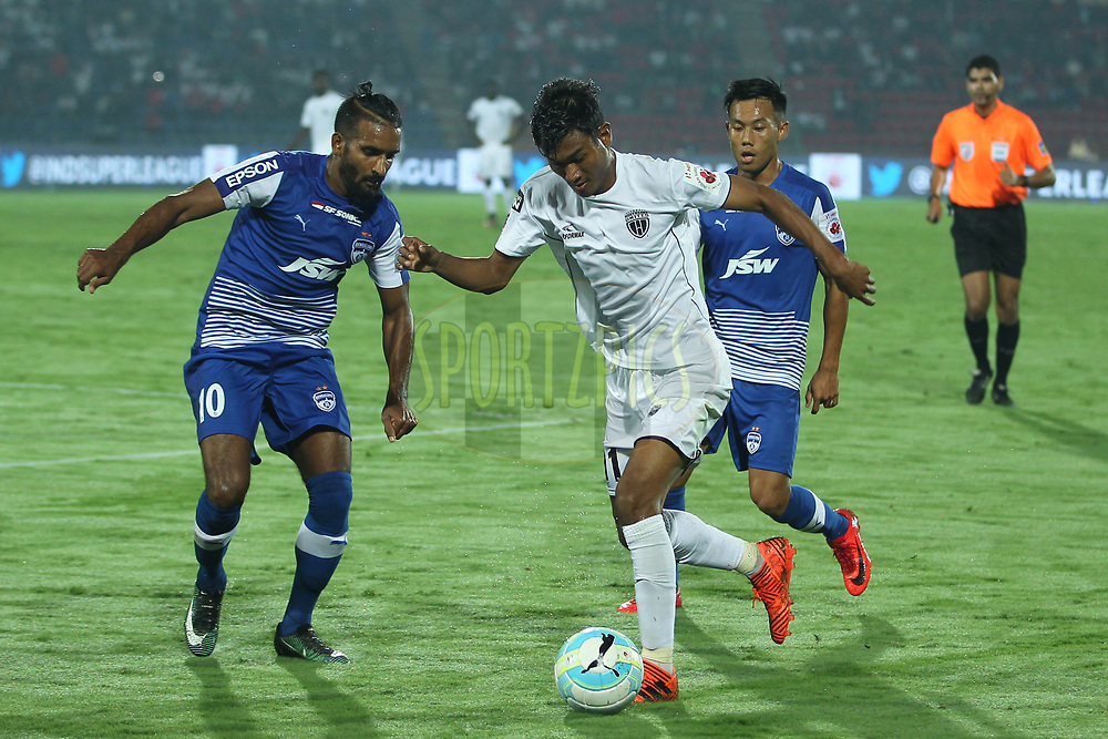 Hali Charan Narzary of Northeast United FC in action during match 19 of the Hero Indian Super League between NorthEast United FC and Bengaluru FC held at the Indira Gandhi Athletic Stadium, Guwahati India on the 8th December 2017<br /> <br /> Photo by: Deepak Malik  / ISL / SPORTZPICS