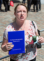 © Licensed to London News Pictures. 06/07/2016. London, UK. Sarah O'Connor, who lost her brother Bob O'Connor in the Iraq war, speaks to media on the day Sir John Chilcot's Report of the Iraq Inquiry is published. The Inquiry was predicated to take approximately one year, but has taken seven. Photo credit : Tom Nicholson/LNP