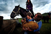 Autistic child Rowan, 5, plays with animals in Mongolia, accompanied by his parents Rupert and Kristin, their Mongolian guide Tulga, his six-year-old son Bodibilguunson and an American documentary TV crew. .Rowan's parents believe horses and shamans can unlock their son's autistic mind. This is their journey of discovery across Mongolia on horseback. .The story is published by the Sunday Times and accompany text by Tim Rayment.