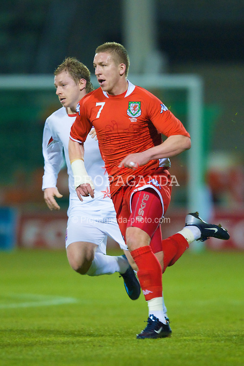 LUXEMBOURG CITY, LUXEMBOURG - Wednesday, March 26, 2008: Wales' Freddy Eastwood and Luxembourg's Alphouse Leweck during the International Friendly match at the Stade Josy Barthel. (Photo by David Rawcliffe/Propaganda)