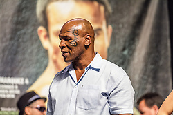 "LAS VEGAS, NV - DEC 7: Mike Tyson on stage at the Pacquiao vs Marquez 4 Weigh In at the MGM Grand Garden Arena in Las Vegas, NV to promote his charity function taking place at the MGM Grand on Friday night. Much of the fans gave him love and cheered for him as he screamed back saying, ""you better come out tonight."" Byline and/or web usage link must  read PHOTO: © Eduardo E. Silva/SILVEX.PHOTOSHELTER.COM."