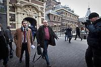 Nederland. Den Haag, 13 januari 2010.<br /> Andre Rouvoet verlaat het ministerie van Algemene Zaken na overleg met premier Balkenende, daags na de presentatie van het rapport van de commissie Davids. De PvdA is erg ongelukkig met de wijze waarop Balkenende gisteren vragen beantwoordde op de persconferentie. Een breuk in de coalitie dreigt. Coalitie, Balkenende IV, vierde kabinet Balkenende<br /> Foto Martijn Beekman
