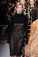 Julia Hafstrom walks the runway wearing Jason Wu Fall 2016, Hair by Paul Hanlon for Morocconoil, Makeup by Yadim for Maybelline, shot by Thomas Concordia during New York Fashion Week on February 12, 2016