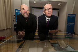A new Scots language website has been launched by the National Library of Scotland called Wee Windaes. It has been developed by the Scots Scriever, Hamish MacDonald who was appointed in 2015 by Creative Scotland to raise awareness of the language.<br /> <br /> Pictured: Hamish MacDonald and Education and Skills Minister John Swinney.
