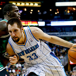 Mar 20, 2013; New Orleans, LA, USA; New Orleans Hornets power forward Ryan Anderson (33) is guarded by Boston Celtics power forward Brandon Bass (30) during the second quarter of a game at the New Orleans Arena. Mandatory Credit: Derick E. Hingle-USA TODAY Sports