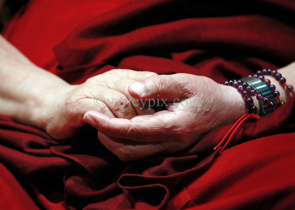 17 May 2013. New Orleans, Louisiana,  USA..The hands of His Holiness the 14th Dalai Lama, in New Orleans for the 'Resiliance - Strength through Compassion and Connection' conference. .The Dalai Lama's hands..Photo; Charlie Varley.