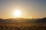 USA, Arizona, Mohave County. Setting sun over the desert of Northern Arizona.