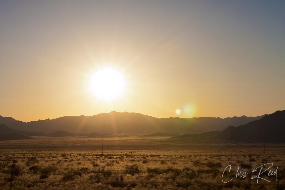 USA, Arizona, Mohave County. Setting sun over the desert of Northern Arizona.