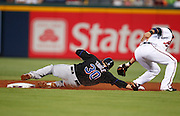 ATLANTA - AUGUST 3:  Catcher Josh Thole #30 of the New York Mets slides under the tag of second baseman Omar Infante #4 of the Atlanta Braves during the game at Turner Field on August 3, 2010 in Atlanta, Georgia.  The Mets beat the Braves 3-2.  (Photo by Mike Zarrilli/Getty Images)