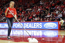 27 November 2015: Ball crew broom girl. Illinois State Redbirds host the Quincy Hawks at Redbird Arena in Normal Illinois (Photo by Alan Look)