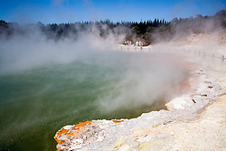 Rotorua, North Island, New Zealand:  People skirting the crusted rim of the Champagne Pool, one of the major thermal features at Waiotapu Thermal Wonderland on the outskirts of Rotorua.