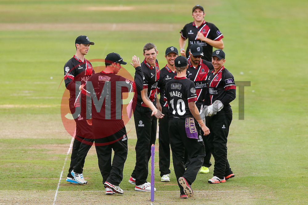 Michael Bates of Somerset celebrates with bowler Craig Overton and teammates after catching out Wes Durston of Derbyshire for 29 - Mandatory byline: Rogan Thomson/JMP - 07966 386802 - 26/07/2015 - SPORT - CRICKET - Taunton, England - County Ground - Somerset v Derbyshire Falcons -Royal London One-Day Cup.
