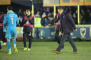 AFC Wimbledon manager Neal Ardley walking off after losing during the The FA Cup third round replay match between AFC Wimbledon and Sutton United at the Cherry Red Records Stadium, Kingston, England on 17 January 2017. Photo by Matthew Redman.