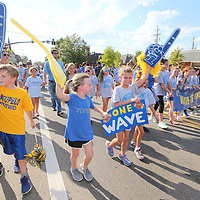 Students from Lawhon Elementary join in Thursday's annual Homecoming Parade alog West Main Street in Tupelo.