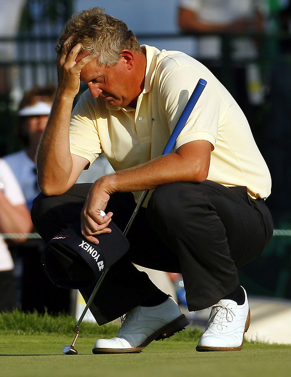 Colin Montgomerie of Scotland waits on the green before attempting his birdie putt on the last hole of the day during the second day of the US Open Golf Championship at Winged Foot Golf Club in Mamaroneck, New York Friday, 16 June 2006.  Montgomerie missed the birdie but tapped in for par, leaving him alone in second place after two rounds.