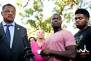 Rev. Jesse Jackson, Josephus Weeks, nephew of Ebola patient Thomas Eric Duncan, and his son Josephus Weeks, Jr. answer questions during a prayer vigil for Duncan at Texas Health Presbyterian Hospital on October 7, 2014, in Dallas. (Cooper Neill for The New York Times)