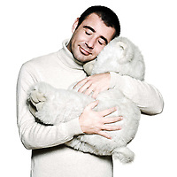 Portrait of a caucasian man hugging a teddy bear in studio on white isolated background