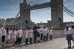London, June 6th 2014. Mayor of London Boris Johnson joins children from Alfred Salter Primary School as  they welcome the Commonwealth Games Queen's Baton Relay to the Capital.