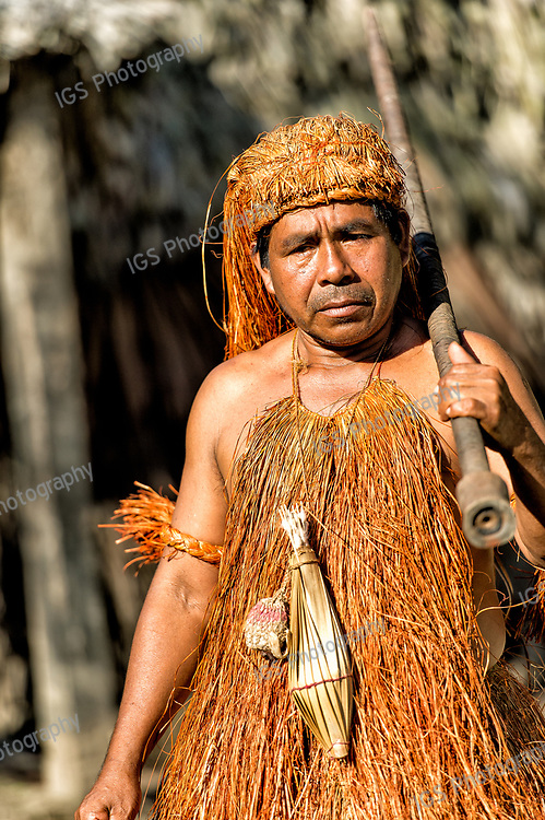 Yagua Indian man with traditional headdress and Pacuna