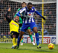 Picture by David Horn/Focus Images Ltd +44 7545 970036<br /> 14/12/2013<br /> Ikechi Anya of Watford is disposessed by Reda Johnson of Sheffield Wednesday during the Sky Bet Championship match at Vicarage Road, Watford.