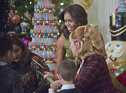 Dec. 2, 2015 - Washington, District of Columbia, United States of America - First lady Michelle Obama helps demonstrate holiday crafts and treats in the State Dining Room as they preview the 2015 White House Christmas decorations in the East Room of the White House in Washington, DC on Wednesday, December 2, 2015.  She was joined by military families who participated in the making of the crafts..Credit: Ron Sachs / CNP (Credit Image: © Ron Sachs/CNP via ZUMA Wire)