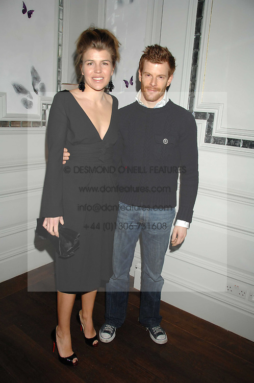 TOM &amp; AMBER AIKENS at a party to launch the Dom Perignon OEotheque 1995 held at The Landau, Portland Place, London W1 on 26th February 2008.<br />
