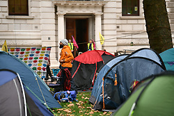 © Licensed to London News Pictures. 07/10/2019. London, UK. Extinction Rebellion activists set up a camp of tents in St James's Park, outside The Treasury in Westminster. Activists plan to converge on Westminster blockading roads in the area for at least two weeks calling on government departments to 'Tell the Truth' about what they are doing to tackle the Emergency. Photo credit: Ben Cawthra/LNP