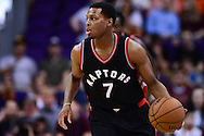 Dec 29, 2016; Phoenix, AZ, USA;  Toronto Raptors guard Kyle Lowry (7) dribbles the ball up the court in the first half of the NBA game against the Phoenix Suns at Talking Stick Resort Arena. The Suns won 99-91. Mandatory Credit: Jennifer Stewart-USA TODAY Sports