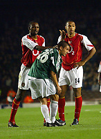 2/11/2004<br />UEFA Champion's League - Arsenal v  Panathiniakos - HIghbury<br />Arsenal's Thierry Henry waits to take a penalty Panathiniakos' Rudolf Skacel stands in the way trying to put the player off. As Arsenal team mate Patrick Vieira helps to remove him.<br />Photo:Jed Leicester/BPI (back page images)
