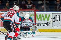 KELOWNA, BC - MARCH 03: Roman Basran #30 of the Kelowna Rockets makes a save against the Portland Winterhawks  at Prospera Place on March 3, 2019 in Kelowna, Canada. (Photo by Marissa Baecker/Getty Images)