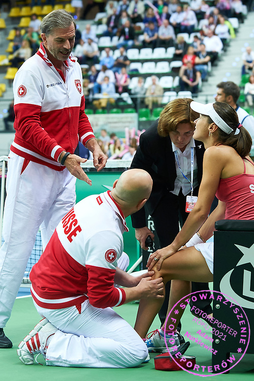 (L) Martina Hingis from Switzerland injured during the Fed Cup / World Group Play Off tennis match between Poland and Switzerland on April 19, 2015 in Zielona Gora, Poland<br /> Poland, Zielona Gora, April 19, 2015<br /> <br /> Picture also available in RAW (NEF) or TIFF format on special request.<br /> <br /> For editorial use only. Any commercial or promotional use requires permission.<br /> <br /> Adam Nurkiewicz declares that he has no rights to the image of people at the photographs of his authorship.<br /> <br /> Mandatory credit:<br /> Photo by &copy; Adam Nurkiewicz / Mediasport