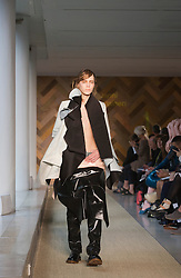 © Licensed to London News Pictures. 29/05/2014. London, England. Collection by Janni Turtiainen. 30 students of the Royal College of Art's prestigious MA Fashion programme presented their final collections in  a runway show at the RCA building in Kensington. Photo credit: Bettina Strenske/LNP
