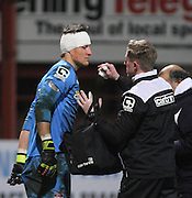 Ross County's physic clears blood from the face of keeper Antonio Reguero - Dundee v Ross County, SPFL Premiership at Dens Park<br /> <br />  - &copy; David Young - www.davidyoungphoto.co.uk - email: davidyoungphoto@gmail.com