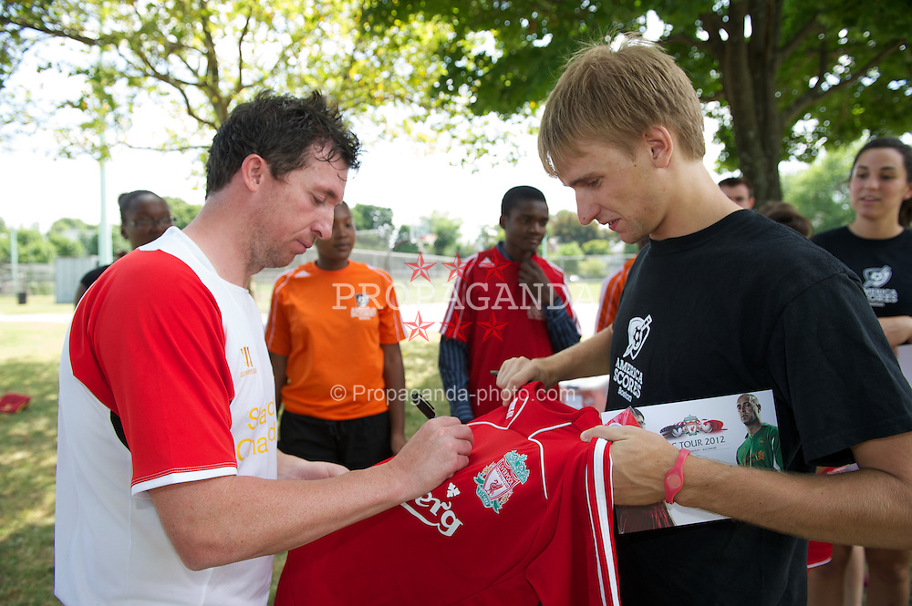 BOSTON, MA - Monday, July 16, 2012: Liverpool's Robbie Fowler signs autographs during a soccer clinic to Dorchester Summer Camp children during the club's North American pre-season tour. (Pic by David Rawcliffe/Propaganda)