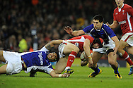 Leigh Halfpenny of Wales is tackled by Samoa's George Pisi (l).  Dove Men series, autumn international rugby international, Wales v Samoa at the Millennium stadium,  Cardiff in South Wales on Friday 16th November 2012.  pic by Andrew Orchard, Andrew Orchard sports photography,