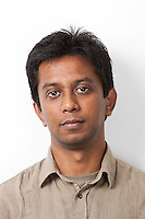 Portrait of young Indian man against white background