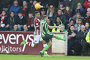 Barry Fuller (Captain) of AFC Wimbledon clears the danger during the Sky Bet League 2 match between Exeter City and AFC Wimbledon at St James' Park, Exeter, England on 28 December 2015. Photo by Stuart Butcher.