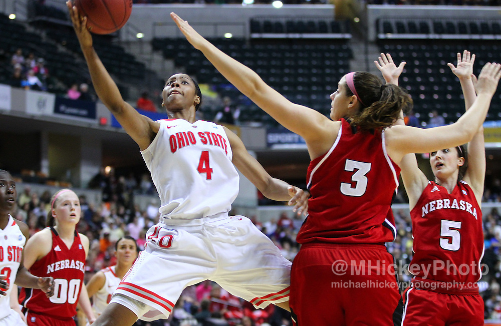 March 03, 2012; Indianapolis, IN, USA; Ohio State Buckeyes guard Tayler Hill (4) puts the ball up as Nebraska Cornhuskers forward Hailie Sample (3) guards during the semifinals of the 2012 Big Ten Tournament at Bankers Life Fieldhouse. Nebraska defeated Ohio State 77-62. Mandatory credit: Michael Hickey-US PRESSWIRE