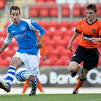 St Johnstone v Dundee United....07.08.12  SPL Under 20 League<br /> Kevin Moon tracked by Scott Smith<br /> Picture by Graeme Hart.<br /> Copyright Perthshire Picture Agency<br /> Tel: 01738 623350  Mobile: 07990 594431