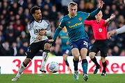Derby County midfielder Duane Holmes and Hull City forward Jarrod Bowen challenge during the EFL Sky Bet Championship match between Derby County and Hull City at the Pride Park, Derby, England on 18 January 2020.