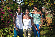 Guanuma, Santo Domingo North - Documented cases of descendants of haitian migrants, born in the Dominican Republic, that do not have access to passport nor documents and are facing deportation - Adonis Peguero (son, left), Celina José (mother, middle) and Celina Peguero (daughter, right). Celina José is Haitian. Her sons were born in the DR but do not have documents so they can not study. Editorial and Commercial Photographer based in Valencia, Spain | Portraits, Hospitality, News, Sports, Media Coverage for Events